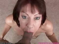 Nasty lady hungrily slurps partner`s massive shaft.