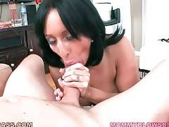 Sexy milf passionately works her mouth at massive dork.