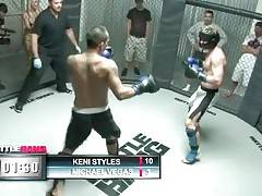 Tough Asian fellow Keni Styles is winning for now.