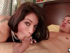 Awesome milf hungrily slurps guy`s thick juicy cock.
