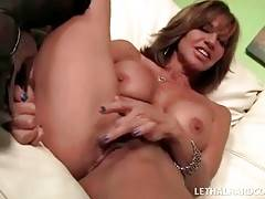 Huge titted milf and her daughter take turns getting fucked.
