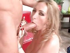 Hot milf readily wraps her lips around partner`s stiff boner.