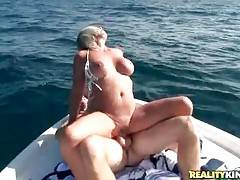 Breasted mature slutie is jumping on younger stud`s shaft.