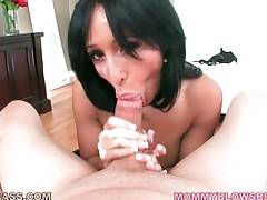 Pretty mature brunette skillfully works her mouth at big dick.