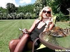 Lovely blond milf seems to be ready to have some fun with cute guy.