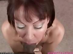 Nasty lady hungrily slurps partner`s massive shaft.